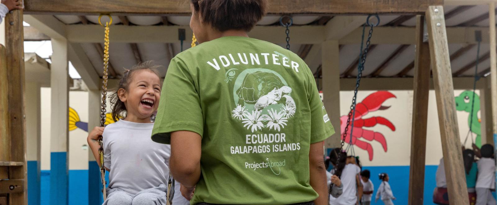 A childcare volunteer in Ecuador supervises children during playtime